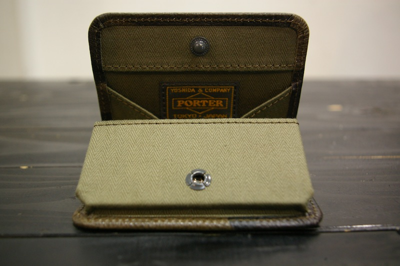 NEXUSVII COIN CASE WITH PORTER