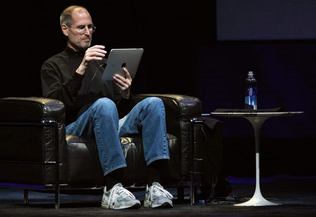 "Apple CEO Steve Jobs uses ""iPad"" during the launch of Apple's new tablet computing device in San Francisco"